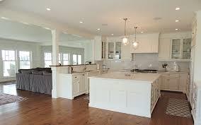custom built cape cod kitchen with hardwood dark hardwood floors