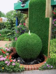 backyard fountain ideas green bush garden fountain creative
