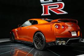 nissan gtr wrapped red 2017 nissan gt r first look review motor trend