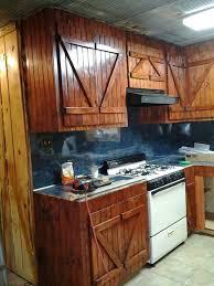 barn door for kitchen cabinets rustic barn door cabinets bead board galvanized tin ceiling