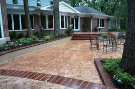 homeowners choose stamped concrete for renovated patio and pool
