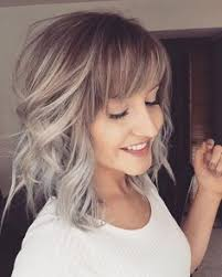 brunette hairstyles wiyh swept away bangs your hair color this spring 17 exles from golden blonde to