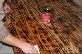 staining a table top diy dining table with burned wood finish using a bernzomatic blow