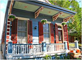 the bright colors of this historic new orleans home suggest the