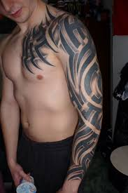 glowing black ink tribal tattoo on biceps real photo pictures