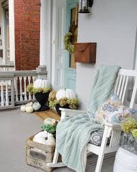 green front porch light fall front porch with white pumpkins and decorations in shades of