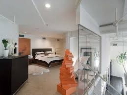 loft interior design and decorating with bold orange color accents