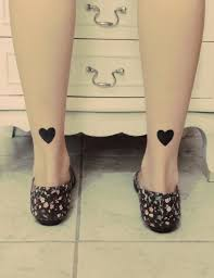 black hearts tattoos on both ankles