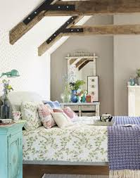 country attic bedroom with bird trellis bed linen featuring our
