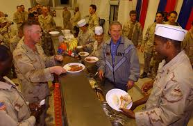 president george w bush meets with troops and serves thanksgiving