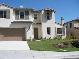 Exterior Garage Door by White Exterior House Color Combination With Brown Garage Door For