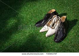 wedding shoes for grass womens mens wedding shoes on green stock photo 716951737