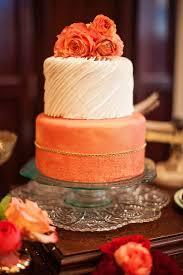 peach fall wedding cake topped with ranunculus deer pearl flowers