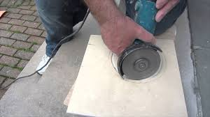 how to cut a in ceramic tile for toilet flange with an angle