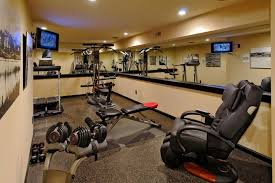 image of a luxury indoor exercise area showing several types of