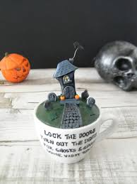 haunted house teacup ornament by madebyizzygifts