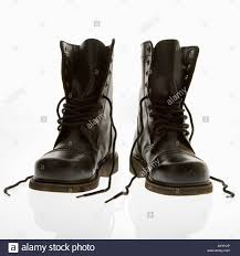 top motorcycle boots black leather high top boots with untied laces stock photo