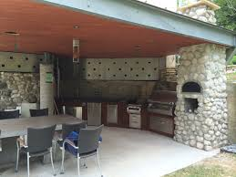Outdoor Kitchen With Sink Metal Roof Completes Houston Modern Outdoor Kitchen