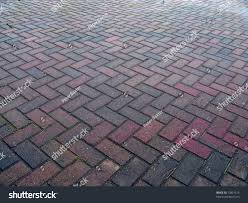 herringbone pattern pavement making great background stock photo