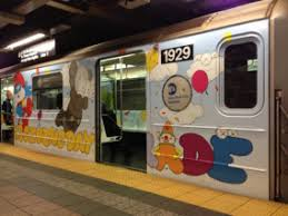 kaws wraps mta subway inside and out for macy s thanksgiving