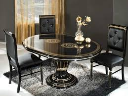 fabulous round black glass dining table with three tufted leather