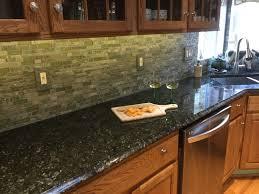 white kitchen cabinets green granite countertops peacock green granite countertops with white cabinets page