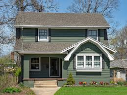 gambrel style roof older two story home with spring flowers stock image image of