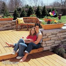 How To Build A Stone Patio by How To Build A Wood And Stone Deck Family Handyman