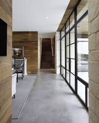 acid stained concrete for a transitional dining room with a wall acid stained concrete for a contemporary hall with a dark wood staircase and hill country residence