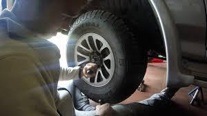 mitsubishi pajero front axle bearing freeplay adjustment youtube