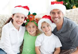 happy family with hats sitting on the sofa stock photo