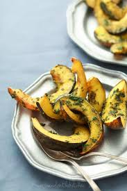 roasted acorn squash with chermoula sauce gourmande in the kitchen