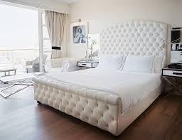 hollywood regency bedroom white velvet tufted headboard in hollywood regency bedroom