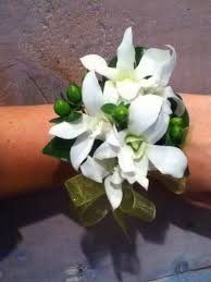white dendrobium orchid and green hypericum corsage camrose hill
