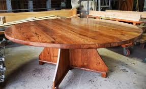 rugged rustic round tables from reclaimed lumber