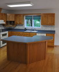 golden oak kitchen cabinets blue formica white walls golden
