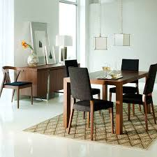 adorable minimalist dining room with round cream dining table and