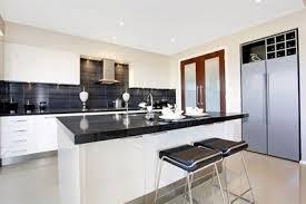 white kitchen cupboards black bench 3100 jet black by caesarstone kitchen black counter