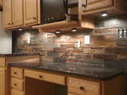 stone backsplash in kitchen polished shades of brown stone backsplash black granite countertop