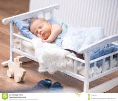 Small Bed by Newborn Baby In A Small Bed Royalty Free Stock Photography Image