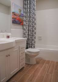 How To Refinish Bathtub Before And After Refinished Tile Bathroom Makeover Curbly