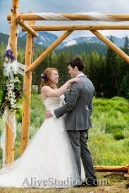 wedding arch log mountain whimsy wedding in breckenridge ja special events