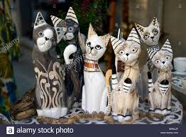 cat cats kitten kittens wood wooden carving carvings stock