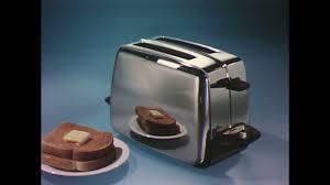 English Toaster United States 1960s Hand Puts Bread In Toaster Close Up Toast