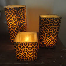 ooooo just got an idea booring candle holders from the dollar cheetah print