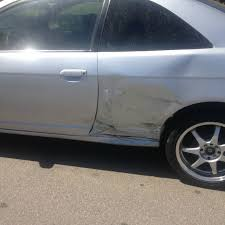 costs to repair huge dent 2001 honda civic pics included