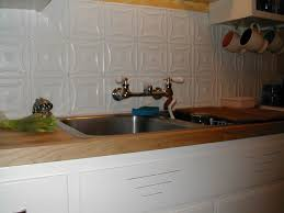 white kitchens with tin back splash tin tile maple counters and