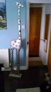silver wooden giraffe ornament originally from the pier now