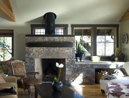 Rustic Living Room by Curved Black Fireplace With Gray Stone Mantel Surround Built In