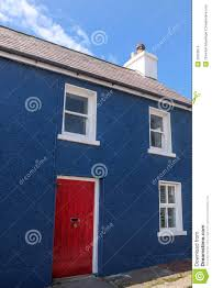 blue painted house with a red door stock images image 36203914